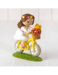 Figura tarta Primera Comunión niña en bici.