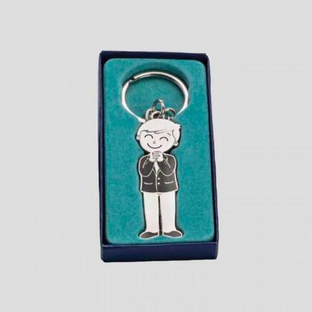 Llavero de metal niño Comunión sonriente en caja de regalo azul