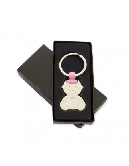 Llavero bebé con chupete y un detalle rosa, en su caja de presentación.