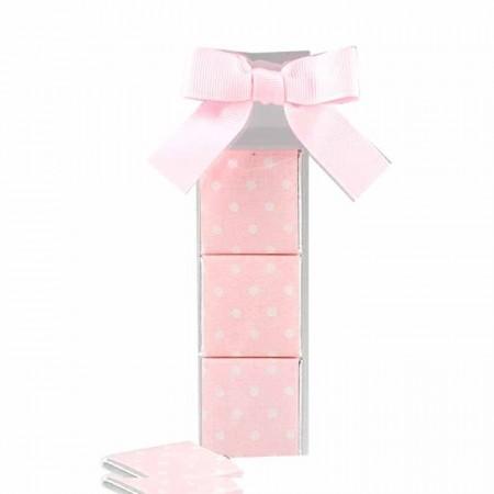 Estuche con lazo rosa y 3 napolitanas decoradas con topos blancos