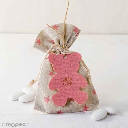 Bolsa algodón estrellitas en rosa con colgante silueta osito rosa y 5 peladillas de chocolate.
