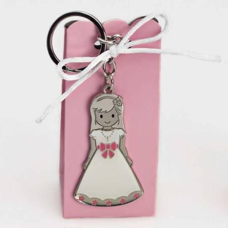 Llavero niña vestida con vestido blanco y lazo rosa en caja semi alta con peladillas