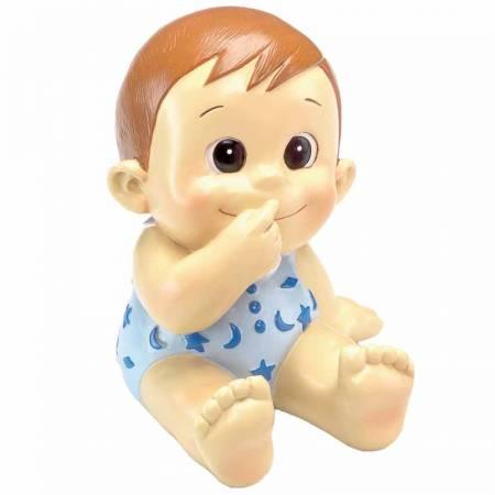 Figura hucha para decorar la tarta de un bautizo que presenta un bebé con pelele en azul con estrellas y luna
