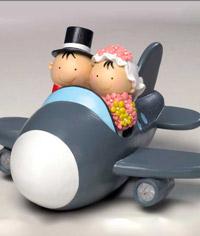 Figura para el pastel de bodas, Pit y Pita novios en avión