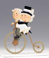 Figura pastel en metal Pit & Pita en bici antigua